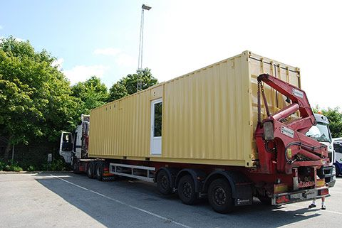 Mobilt pakkeri container på lastbil