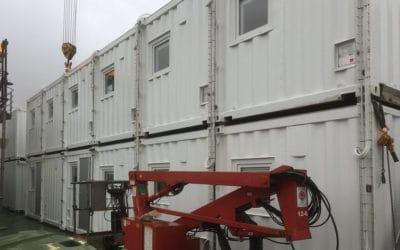 Aptering i container til fartøj