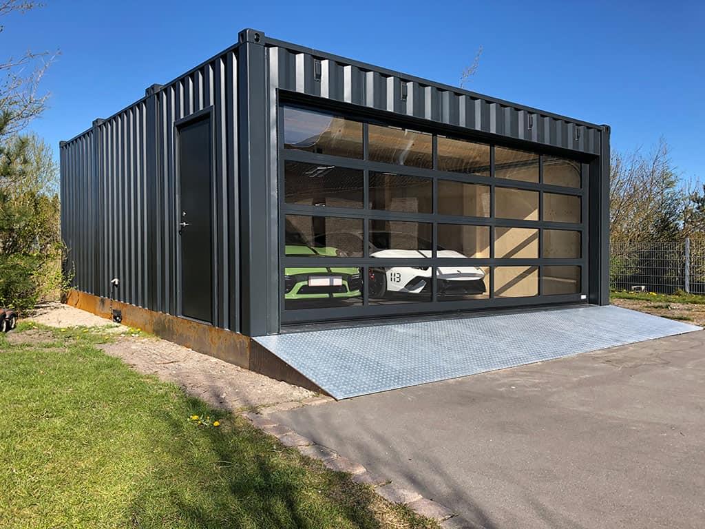 Isoleret garage container med elektrisk port fra DC-Supply